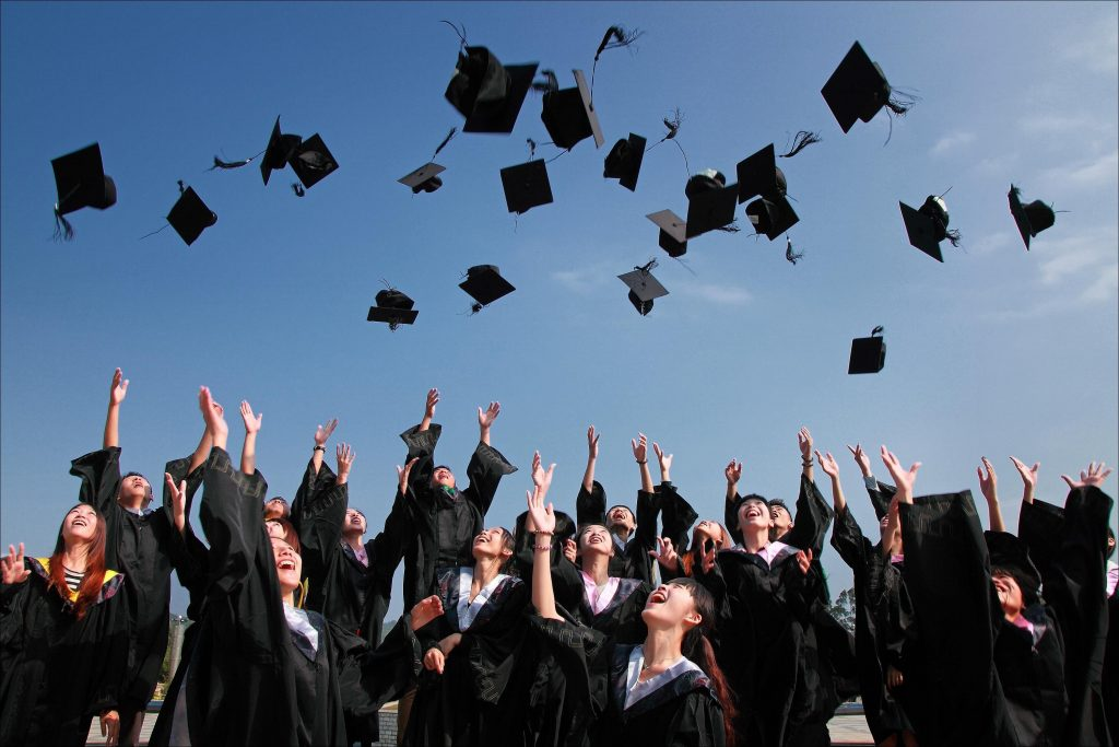 graduates throwing hats advice for high school graduates
