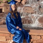 girl in graduation cap and gown