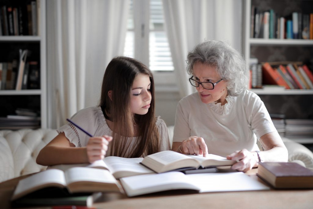 older woman mentoring a  young teen